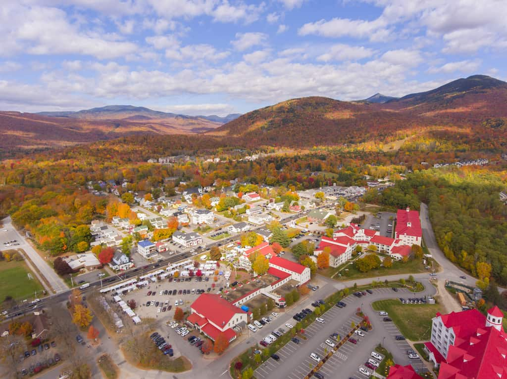 An aerial view of downtown Lincoln, New Hampshire and RiverWalk Resort in the fall.