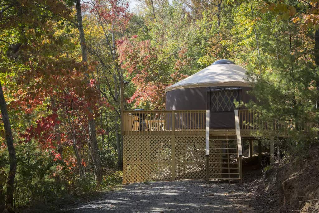 A beautiful yurt available for rent in Asheville, NC for your glamping trip on the Blue Ridge Parkway. Photo credit: VRBO