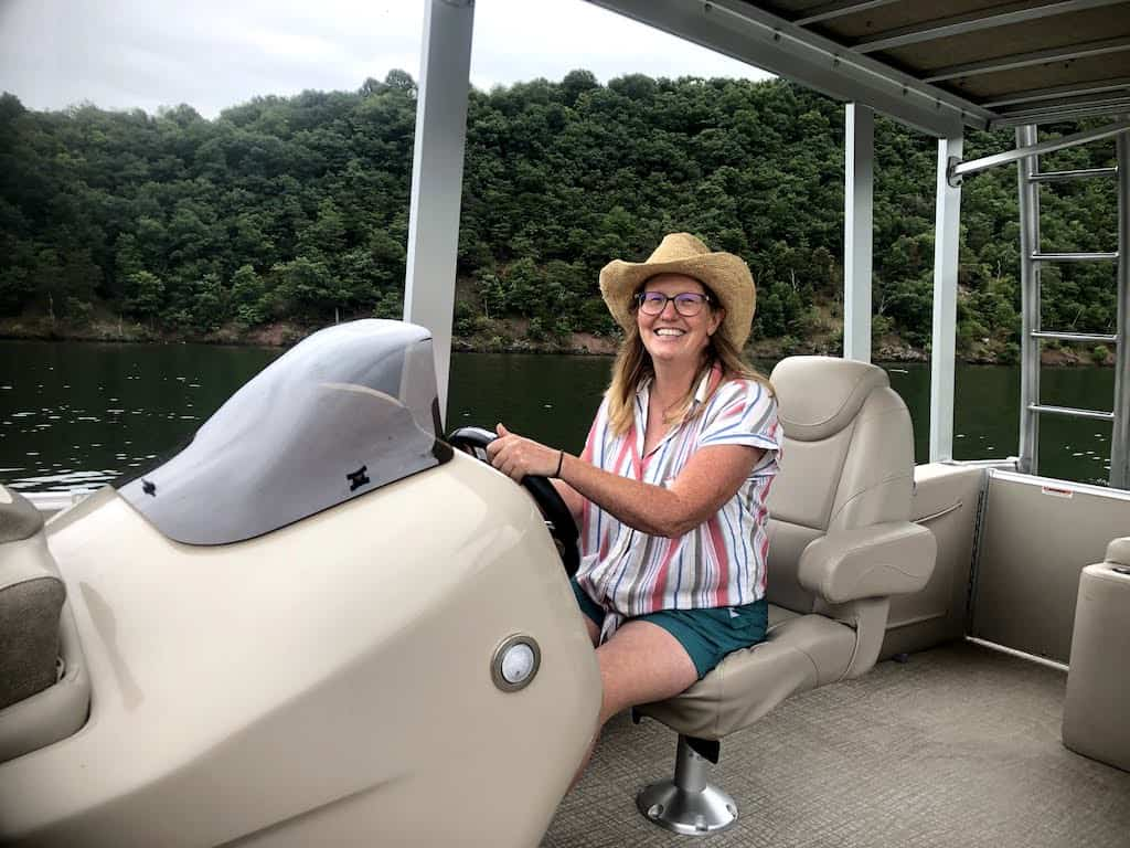 The author driving a boat for the first time on Raystown Lake in Pennsylvania.