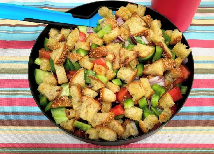 a plate of panzanella salad for camping.
