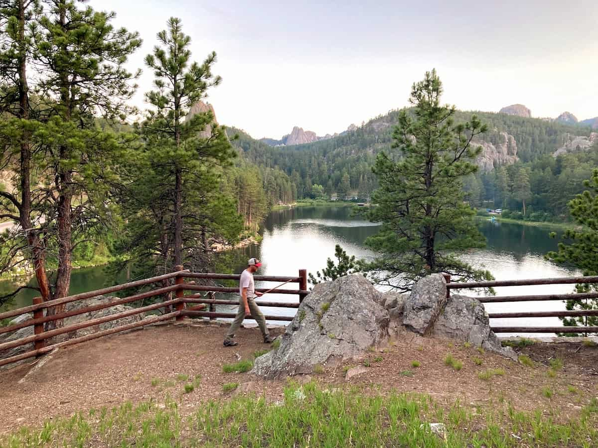 A man walks along the overview of Horsethief Lake in the Black Hills of South Dakota.