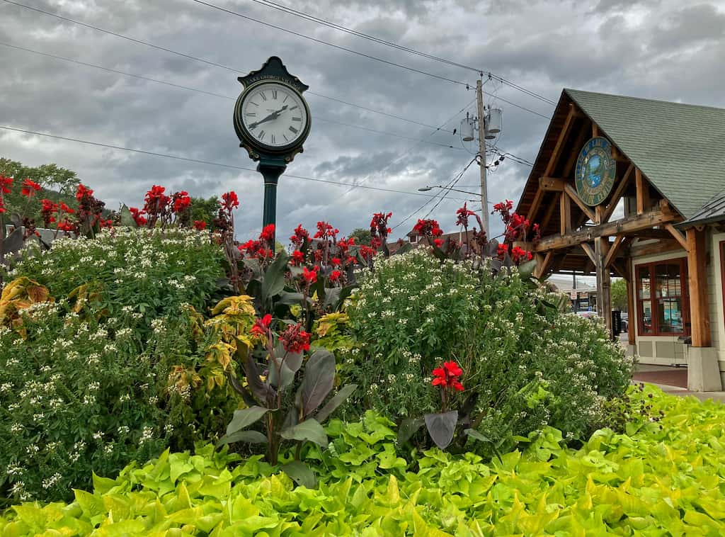 The gardens and clock in front of the Lake George Visitor Center in New York.