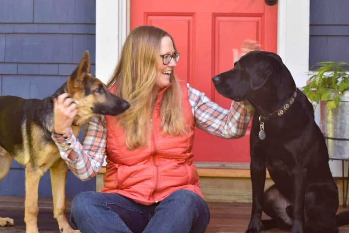 Tara Schatz sits with her two dogs, Gatsby and Flynn.